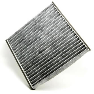 A piece of pleated carbon filter with foam frame on the white background.