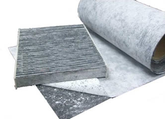 A roll of sandwich activated carbon cloth and a piece of pleated carbon filter.