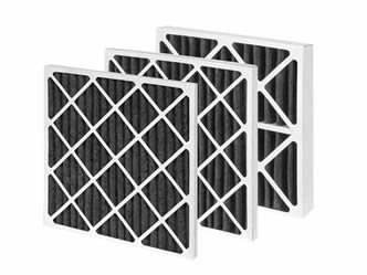 Three pieces of pleated carbon filter with paperboard support layer.