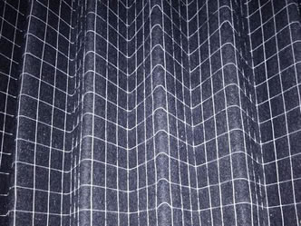 A piece of pleated filter with welded wire mesh support layer.